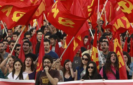 Supporters of the Greek Communist Party shout slogans during an election campaign rally in Athens May 2, 2012. Greece will call a snap election for May 6. REUTERS/John Kolesidis