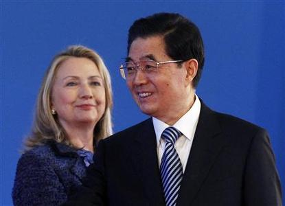 China's President Hu Jintao (R) smiles as U.S. Secretary of State Hillary Clinton looks on during the opening ceremony of the U.S.-China Strategic and Economic Dialogue at the Diaoyutai Guesthouse in Beijing May 3, 2012. REUTERS/Shannon Stapleton