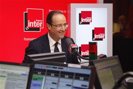 Francois Hollande, Socialist party candidate for the 2012 French presidential elections, attends an interview at the France Inter radio station studios in Paris May 3, 2012. REUTERS/Benoit Tessier