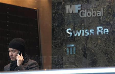 A man talks on the phone inside the office complex where MF Global Holdings Ltd have an office on 52nd Street in midtown Manhattan New York, October 31, 2011. REUTERS/Brendan McDermid