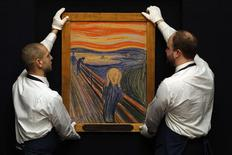 "Sotheby's employees pose for a photograph with Edvard Munch's painting ""The scream"" at Sotheby's auction house in London in this April 12, 2012 file photo. REUTERS/Stefan Wermuth"