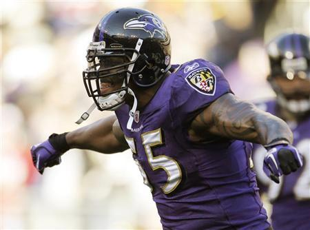 Baltimore Ravens outside linebacker Terrell Suggs celebrates a defensive play in the third quarter against the Houston Texans during their NFL AFC Divisional playoff football game in Baltimore, Maryland, January 15, 2012. REUTERS/Jonathan Ernst