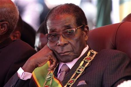 Zimbabwe's President Robert Mugabe looks on during a rally marking Zimbabwe's 32nd independence anniversary celebrations in Harare April 18, 2012.REUTERS/Stringer