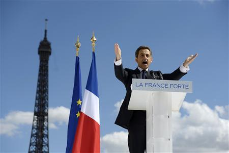 France's President and UMP party candidate for his re-election in the 2012 French presidential elections, Nicolas Sarkozy, waves to supporters as he arrives on stage at Trocadero square to deliver a speech during a campaign rally in front of the Eiffel Tower in Paris May 1, 2012. REUTERS/Eric Feferberg/Pool