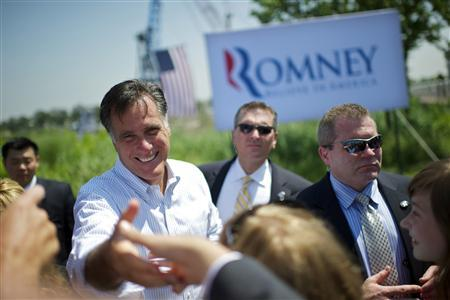 U.S. Republican presidential candidate and former Massachusetts Governor Mitt Romney shakes hands with supporters during a rally at Crofton Industries in Portsmouth, Virginia May 3, 2012. REUTERS/Mark Makela