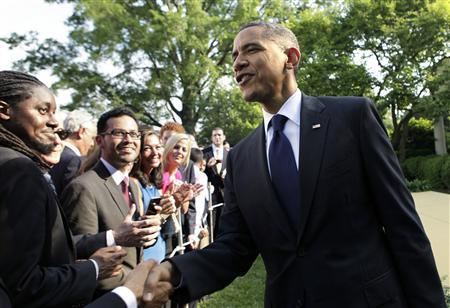 President Barack Obama greets guests at a Cinco de Mayo reception in the Rose Garden of the White House in Washington, May 3, 2012. REUTERS/Yuri Gripas