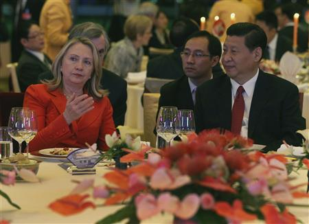 U.S. Secretary of State Hillary Clinton sits with Chinese Vice President Xi Jinping (R) during a dinner at the Diaoyutai Guesthouse in Beijing, May 3, 2012. REUTERS/Shannon Stapleton
