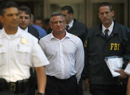 File photo of Ross Mandell, President and CEO of Sky Capital Holdings Ltd, being escorted by FBI agents after surrendering in New York, July 8, 2009. REUTERS/Brendan McDermid