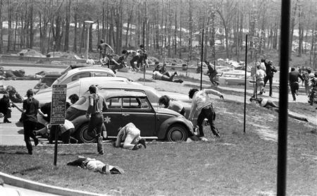 FILE PHOTO 4MAY70 - Students dive to the ground as the Ohio National Guard fires on faculty and students at Kent State University in this May 4, 1970 file photo. MMR/AA