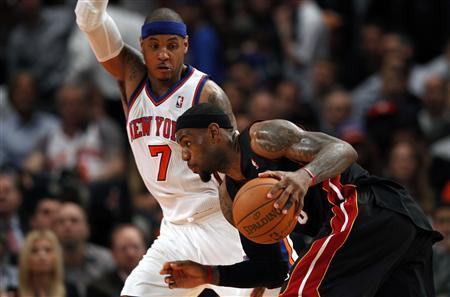 Miami Heat's LeBron James (front) drives past New York Knicks' Carmelo Anthony during the second half of Game 3 of their NBA Eastern Conference basketball playoff series in New York, May 3, 2012. REUTERS/Mike Segar