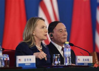 U.S. Secretary of State Hillary Clinton (L) gestures as she speaks next to China's Vice Premier Wang Qishan at the joint statement reading for the closing of the US-China Strategic and Economic Dialogue at Diaoyutai State Guesthouse in Beijing May 4, 2012. Clinton told Chinese President Hu Jintao on Friday that relations between their two countries were the strongest they had ever been, even as the two countries are engaged in a spat over China's treatment of a blind dissident. REUTERS-Jason Lee