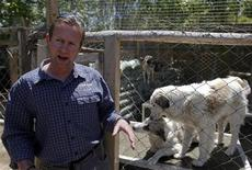 Pen Farthing, founder of British charity Nowzad, an animal shelter, stands in front of a cage on the outskirts of Kabul May 1, 2012. A former Royal Marine, Farthing adopted his dog Nowzad, named after a Helmand district, during his tour there in 2006. He then set up the charity, where dogs and some cats are neutered and vaccinated against rabies before their journeys abroad. Nowzad has given homes to over 330 dogs since it was founded, mostly to soldiers from the U.S. and Britain, but also from South Africa, Australia, Canada and the Netherlands. Picture taken May 1, 2012. REUTERS/Omar Sobhani