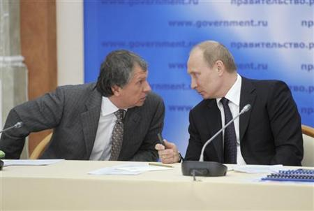 Russian Prime Minister and President-elect Vladimir Putin (R) and Deputy Prime Minister Igor Sechin attend a meeting on the gas industry in Kirishi, a town near St Petersburg in Leningrad Region, March 23, 2012. REUTERS/Aleksey Nikolsky/RIA Novosti/Pool