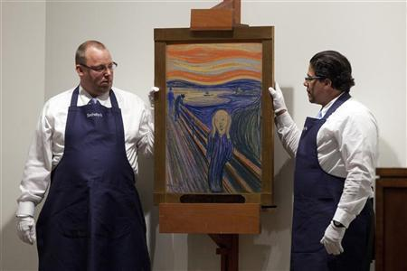 Employees hold ''The Scream'' painted by Edvard Munch at a Sotheby's auction in New York May 2, 2012. REUTERS/Andrew Burton