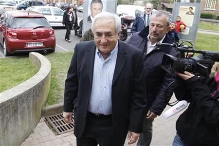 Former IMF head Dominique Strauss-Kahn leaves after he voted in the first round of the 2012 French presidential election at a polling station in Sarcelles April 22, 2012. REUTERS/Gonzalo Fuentes