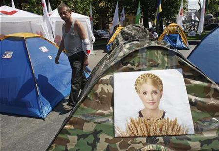 A man walks past tents for supporters of jailed opposition leader Yulia Tymoshenko in Lviv May 4, 2012. REUTERS/Gleb Garanich