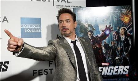 Robert Downey Jr. poses as he arrives at the screening of the film ''Marvel's The Avengers'' for the closing night of the 2012 Tribeca Film Festival in New York April 28, 2012. REUTERS/Andrew Kelly