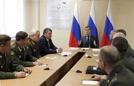 Russian President Dmitry Medvedev (C) gestures during a meeting with military officials in the Kaliningrad region November 29, 2011. REUTERS/Mikhail Klimentyev/RIA Novosti/Kremlin