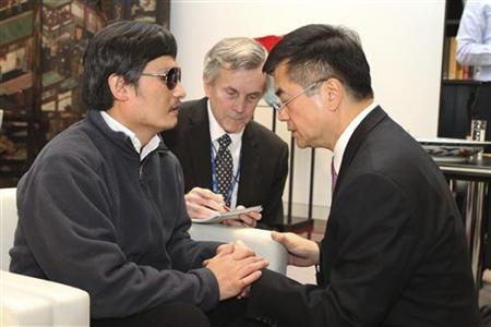 A handout photo from the U.S. Embassy Beijing Press office shows U.S. Ambassador to China Gary Locke (R) holding blind activist Chen Guangcheng's (L) hands as they talk in Beijing, May 2, 2012. Picture taken May 2, 2012. REUTERS/US Embassy Beijing Press Office/Handout CLIENTS