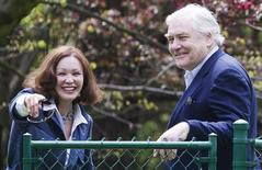 Former media mogul Conrad Black and his wife Barbara Amiel smile as he arrives at his home in Toronto, May 4, 2012. REUTERS/Mark Blinch
