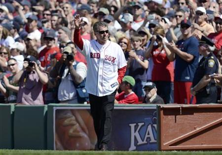 Former Boston Red Sox player Bill Buckner waves as he takes to the field during the pre-game ceremony as Fenway Park commemorates its 100th year anniversary before the start of American League MLB baseball game between the Boston Red Sox and New York Yankees at Fenway Park in Boston, Massachusetts April 20, 2012. REUTERS/Gretchen Ertl