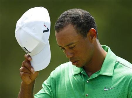 Tiger Woods tips his cap after finishing his round during the second round of the Wells Fargo Championship PGA golf tournament in Charlotte, North Carolina May 4, 2012. REUTERS/Chris Keane