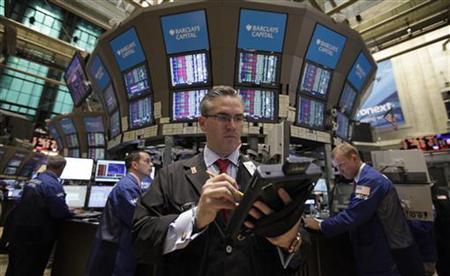 Traders work on the floor of the New York Stock Exchange August 8, 2011. REUTERS/Brendan McDermid/Files