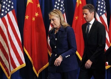 U.S. Secretary of State Hillary Clinton (L) and U.S. Treasury Secretary Timothy Geithner leave the stage of a news conference in Beijing May 4, 2012. REUTERS/Shannon Stapleton