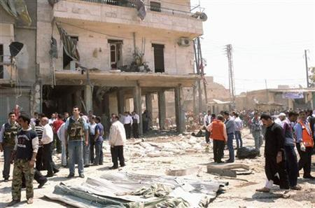 People gather at the site of an explosion in Aleppo city May 5, 2012. REUTERS/George Ourfalian