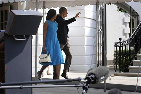 U.S. President Barack Obama (2nd L) and first lady Michelle Obama (L) wave as they depart for events in Ohio and Virginia to officially kick off his 2012 re-election campaign, from the White House in Washington, May 5, 2012. REUTERS/Jonathan Ernst
