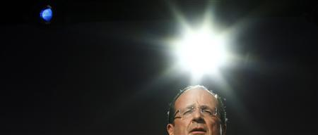 Francois Hollande, Socialist Party candidate for the 2012 French presidential election, delivers a speech during a campaign rally in Toulouse May 3, 2012. REUTERS/Jacky Naegelen