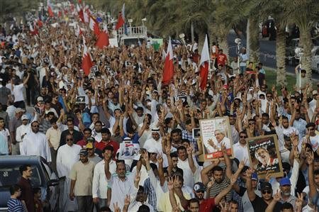 People march during an anti-government protest organised by Al Wefaq, on Budaiya highway, west of Manama, May 4, 2012. REUTERS/Stringer