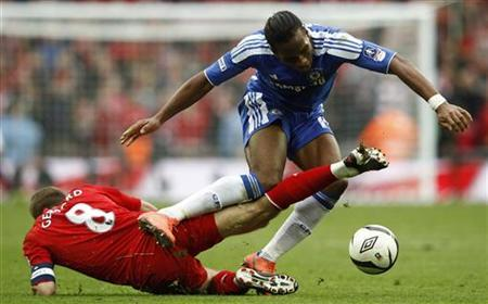 Chelsea's Didier Drogba (R) is challenged by Liverpool's Steven Gerrard during their FA Cup final soccer match at Wembley Stadium in London, May 5, 2012. REUTERS/Eddie Keogh