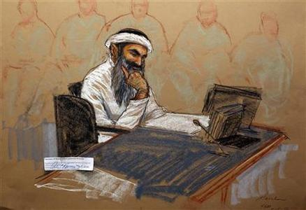 Accused 9/11 mastermind Khalid Sheik Mohammed is shown during his military commission hearing in this courtroom sketch reviewed and approved for release by a U.S. military security official, at Guantanamo Bay Navy Base, Cuba, May 5, 2012. REUTERS/Janet Hamlin/Pool