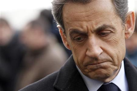 France's President and UMP party candidate for the 2012 French presidential elections Nicolas Sarkozy talks to the media as he arrives at French engineering giant Alstom plant in Aytre, western France, February 21, 2012. REUTERS/Stephane Mahe