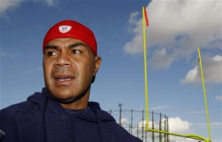 New England Patriots Junior Seau speaks to reporters before training at the Oval Cricket Ground ahead of their NFL game against Tampa Bay Buccaneers in London October October 23, 2009. REUTERS/Luke MacGregor