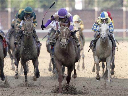 I'll Have Another with jockey Mario Gutierrez (C) in the irons wins the 138th Kentucky Derby ahead of Bodemeister at Churchill Downs in Louisville, Kentucky, May 5, 2012. REUTERS/Jeff Haynes