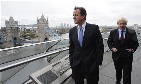 Britain's Prime Minister David Cameron (L) and London Mayor Boris Johnson stand on a balcony at City Hall in central London May 5, 2012. REUTERS/Stefan Rousseau/Handout