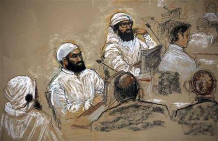 In this file photo of a sketch by courtroom artist Janet Hamlin, reviewed by the U.S. military, alleged September 11 co-conspirators (L) sit with their legal teams inside the courtroom during a hearing at the Camp Justice compound for the U.S. war crimes commission, at Guantanamo Bay U.S. Naval Base, July 16, 2009. REUTERS/Janet Hamlin/Pool/Files