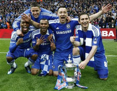 Chelsea's (from L) Salomon Kalou, Gary Cahill, Ashley Cole, John Terry and Frank Lampard celebrate after their FA Cup final soccer match against Liverpool at Wembley Stadium in London, May 5, 2012. REUTERS/Eddie Keogh