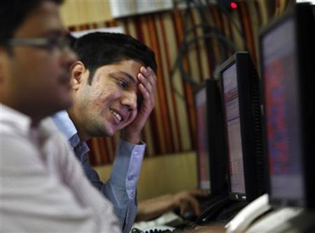 A dealer reacts while trading at a stock brokerage firm in Kolkata May 7, 2010. REUTERS/Parth Sanyal/Files