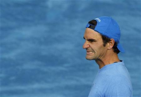 Roger Federer of Switzerland reacts during a training session at the Madrid Open tennis tournament in Madrid May 4, 2012. REUTERS/Andrea Comas