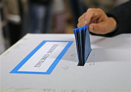A man casts his ballot at a polling station in Cvitavecchia, 70 km (43 miles) north of Rome May 6, 2012. REUTERS/Giampiero Sposito