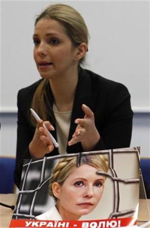 A poster of imprisoned Ukrainian former Prime Minister Yulia Tymoshenko is seen as her daughter Evgenia Tymoshenko speaks at a news conference in Prague April 30, 2012. REUTERS/David W Cerny