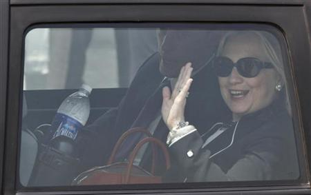 U.S. Secretary of State Hillary Clinton waves from a car upon her arrival at the airport in Kolkata May 6, 2012. REUTERS/Rupak De Chowdhuri