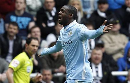 Manchester City's Yaya Toure celebrates scoring a goal against Newcastle United during their English Premier League soccer match in Newcastle, north east England May 6, 2012. REUTERS/David Moir