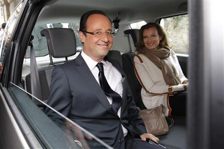 Francois Hollande (L), Socialist Party candidate for the 2012 French presidential election, and his companion Valerie Trierweiler sit in a car as they leave a polling station in Tulle during the second round of the 2012 French presidential election May 6, 2012. REUTERS/Stephane Mahe