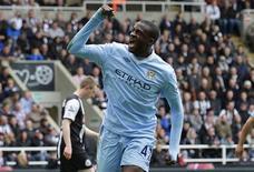Yaya Toure, do Manchester City, comemora seu segundo gol contra o Newcastle United, durante o Campeonato Inglês, em Newcastle, nordeste da Inglaterra. 06/05/2012 REUTERS/David Moir
