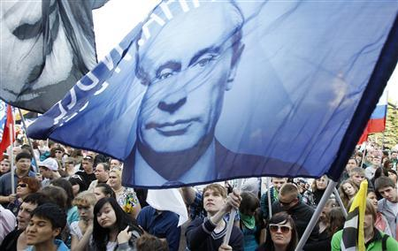 Supporters of Prime Minister and President-elect Vladimir Putin wave flags during a supporters rally in central Moscow May 6, 2012. REUTERS/Sergei Karpukhin