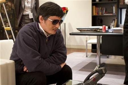 A handout photo from the U.S. Embassy Beijing Press office shows blind activist Chen Guangcheng (C) speaking into a phone in Beijing, May 2, 2012. Picture taken May 2, 2012. REUTERS/US Embassy Beijing Press Office/Handout